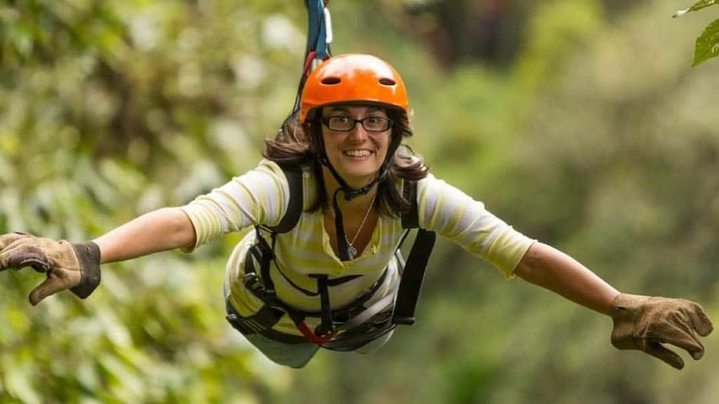 girl-doing-canopy-in-baños-ecuador