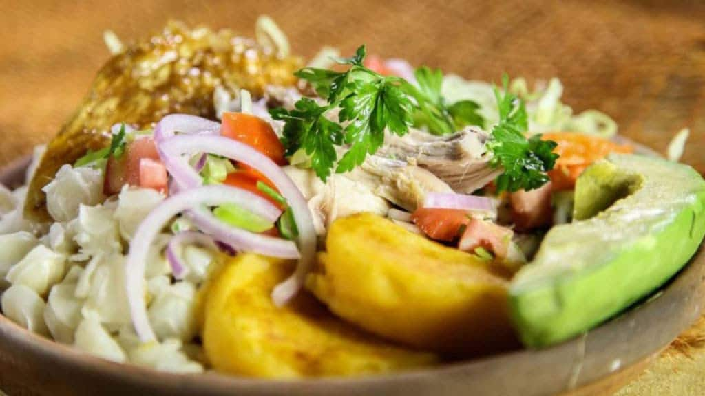 The high-fat, low-carb diet in Ecuador - a plate of roast chicken with more and llapingachos