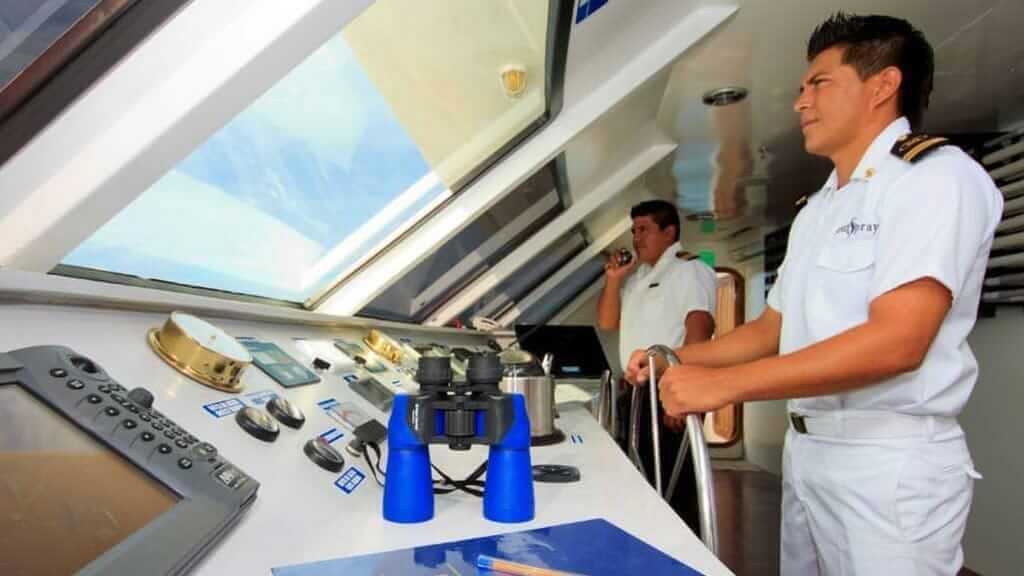 ocean spray yacht crew navigating at galapagos islands