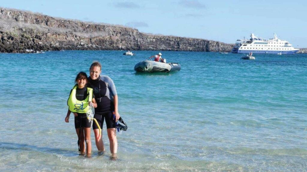 Mother and daughter snorkeling at the galapagos islands