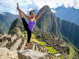 tourist in yoga pose at machu picchu peru