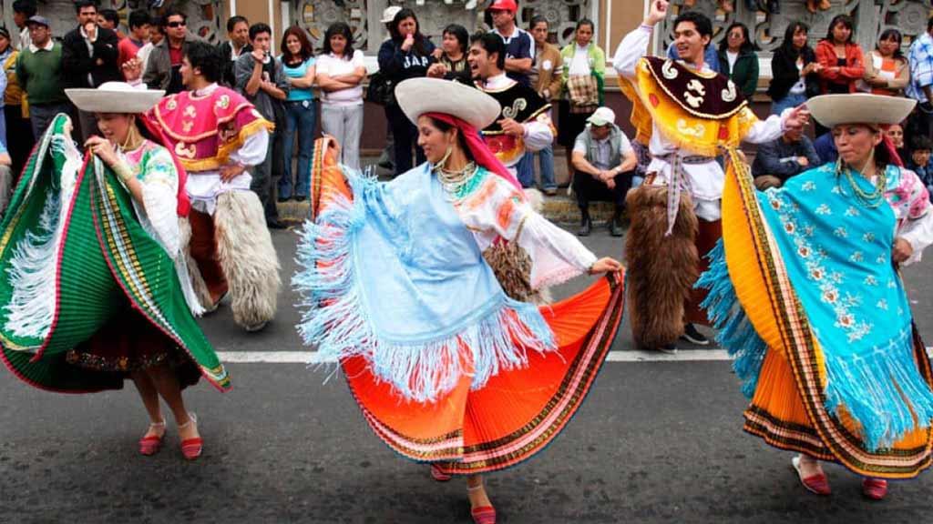 indigenous women dancing - ecuador travel destination
