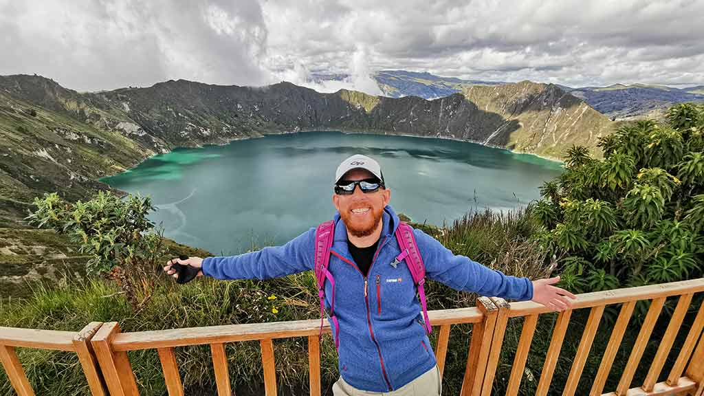 happy tourist at quilotoa ecuador