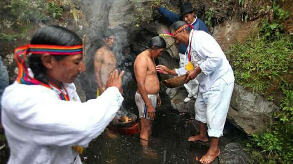 Ritual waterfall Bathing to celebrate inti raymi in ecuador