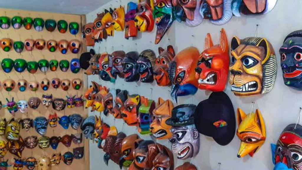 quilotoa handicraft market shopping for painted masks