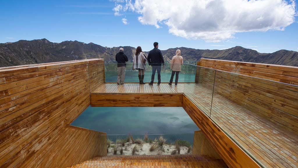 4 tourists at quilotoa lake lookout shalala