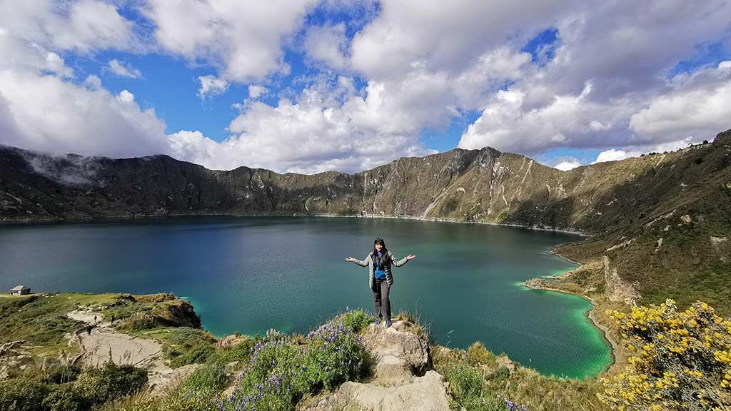 a female tourist posing at crater lake quilotoa ecuador